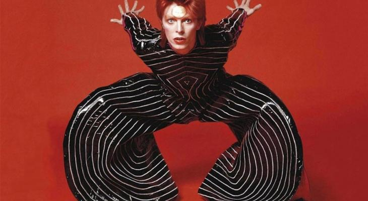 David Bowie in a striped pant suit