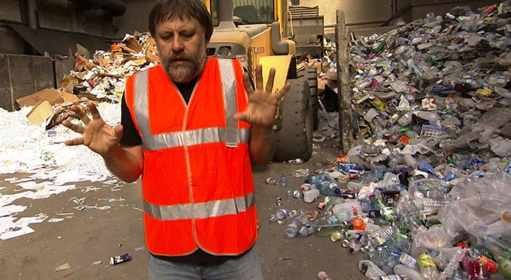 Person standing in front of garbage
