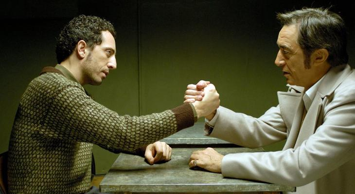 two men facing each other and arm wrestling
