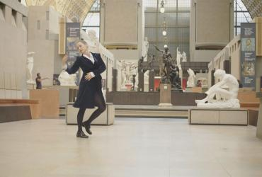 Person dancing in a museum