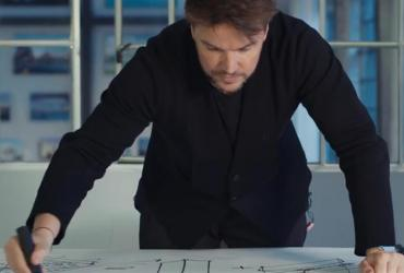 Bjarke Ingels looking at building design plans
