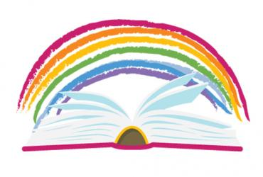 Colourful rainbow on top of an open book