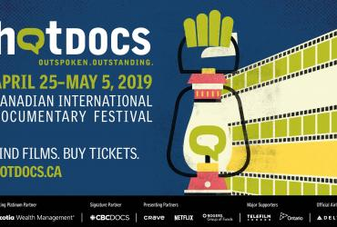 Hot Docs Festival 2019 creative with a glowing lantern and beams of light as film strips