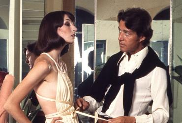 Designer Halston with a model