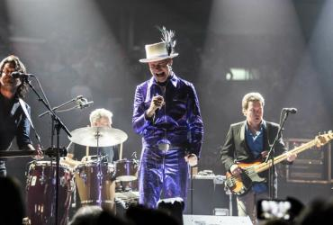 The Tragically Hip performing on stage