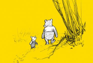 Winnie and Piglet walking on a trail