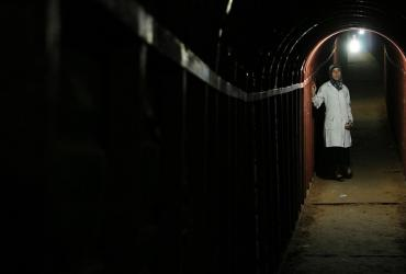 Person standing in a tunnel