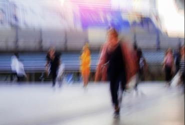blurred image of people walking